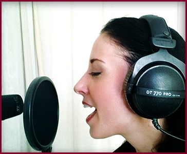 Stine Grove recording vocals in studio